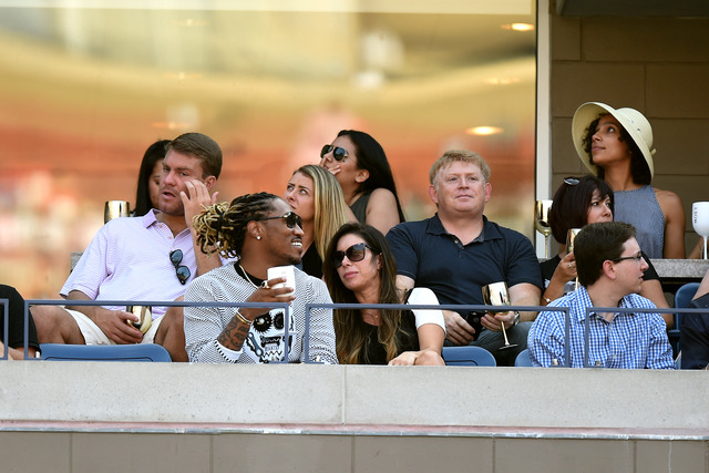 Recording artist Future catches the action in Arthur Ashe Stadium on Day 12 of the 2014 US Open.