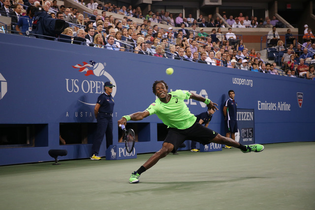 Gael Monfils takes on Roger Federer on Day 11 of the 2014 US Open.