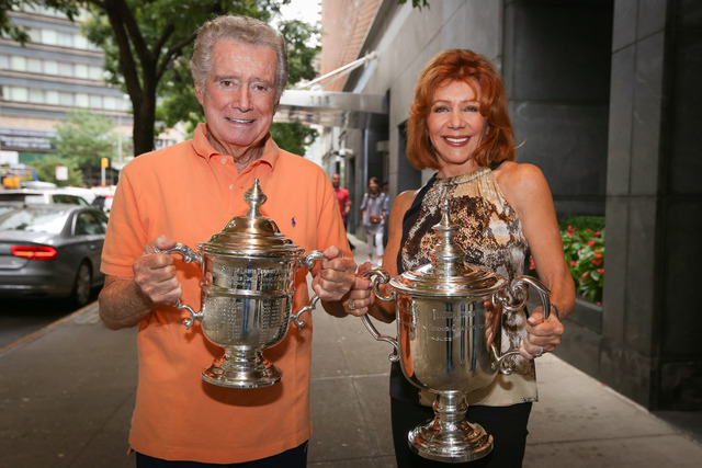Entertainment icon Regis Philbin and his wife Joy proudly held the US Open trophies.
