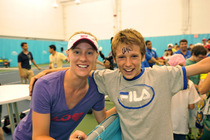 Alison Riske poses with a fan who is sporting her autograph on his forehead.