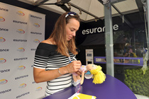 Martina Hingis signs autographs and poses for pictures with fans at the esurance booth on Day 7 at the 2013 US Open.
