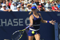 Eugenie Bouchard, seeded seventh, battles against No. 17 Ekaterina Makarova in the fourth round.