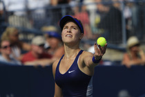 No. 7 seed Eugenie Bouchard in action against No. 17 Ekaterina Makarova on Day 8 in Louis Armstrong Stadium.
