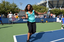 Laila Ali at the Billie Jean King National Tennis Center hosting a youth tennis exhibition at the US Open