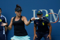No. 29 seed Casey Dellacqua in action against No. 11 Flavia Pennetta in Arthur Ashe Stadium.