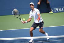 Top seed Novak Djokovic in action against No. 22 Philipp Kohlschreiber on Day 8 in Louis Armstrong Stadium.