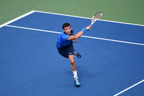Grigor Dimitrov follows through on an approach shot in the second set of his match with Gael Monfils.