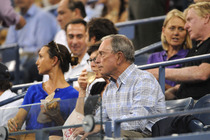 Former New York City Mayor Michael Bloomberg watches Roger Federer in action in Arthur Ashe Stadium at the 2014 US Open.
