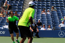 Scott Lipsky and Rajeev Ram battle No. 12 seeds Eric Butorac and Raven Klaasen on Day 9 of the 2014 US Open.