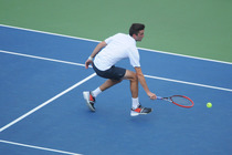 France's Gilles Simon battles Croatia's Marin Cilic in fourth-round action.