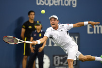 Roberto Bautista Agut stretches for a forehand during a fourth-round match against Roger Federer in Arthur Ashe Stadium.