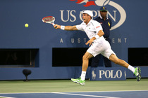 Roberto Bautista Agut attacks a forehand during his fourth-round match in Arthur Ashe Stadium.