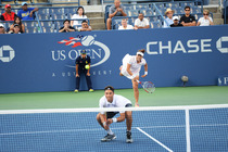Yung-Jan Chan serves in a mixed doubles semifinal match on Day 9 of the 2014 US Open.