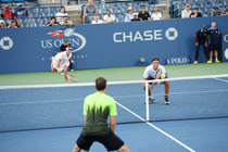 Ross Hutchins in action in a mixed doubles semifinal match on Day 10 of the 2014 US Open.