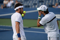 Carlos Berlocq and Leonardo Mayer of Argentina in quarterfinals action against Ivan Dodig of Croatia and Marcelo Melo of Brazil on Day 10 of the 2014 US Open.