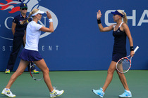 Ekaterina Makarova and Elena Vesnina of Russia battle Kimiko Date-Krumm of Japan and Barbora Zahlavova Strycova of the Czech Republic on Day 11 of the 2014 US Open.