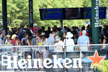 Fans enjoy a break from the action at the Heineken House on the grounds of the USTA Billie Jean King National Tennis Center.