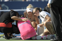 Caroline Wozniaki consoles Peng Shuai, who retired in the second set of her women's semifinal match on Day 12.
