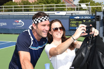 A fan takes a selfie with Pat Cash at the USTA Foundation Pro-Am Tournament.