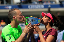 We have champions! The first title earned at the 2014 US Open is in mixed doubles, won by Brazilian Bruno Soares and Sania Mirza of India.