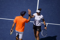 Santiago Gonzalez and Abigail Spears celebrate a point against Max Mirnyi and Andrea Hlavackova in their mixed doubles final match on Day 12 at the 2013 US Open.