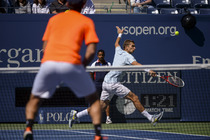 Max Mirnyi reaches for a shot while playing with teammate Andrea Hlavackova against Santiago Gonzalez and Abigail Spears in their mixed doubles final match on Day 12 at the 2013 US Open.