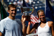 Andrea Hlavackova and Max Mirnyi hold the mixed doubles championship trophy after taking the title 7-6, 6-3 over Abigail Spears and Santiago Gonzalez.