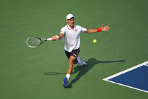 Novak Djokovic in action in the men's semifinal on Day 13 of the 2014 US Open.