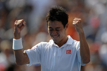 Kei Nishikori celebrates his semifinal victory over Novak Djokovic in Arthur Ashe Stadium.