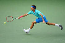 Roger Federer chases after a forehand during a semifinal match against Marin Cilic in Arthur Ashe Stadium.