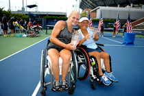 Yui Kamiji and Jordanne Whiley pose with their trophies after winning the Wheelchair Women's Doubles final.