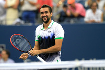 Marin Cilic celebrates his semifinal victory over Roger Federer at the 2014 US Open in Arthur Ashe Stadium.