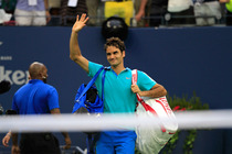 Roger Fedeer leaves the court after losing his semifinal match against Marin Cilic in Arthur Ashe Stadium.