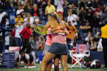 Lucie Hradecka and Andrea Hlavackova celebrate their 6-7, 6-1, 6-4 victory against Ashleigh Barty and Casey Dellacqua in their doubles final match on Day 13 of the 2013 US Open.