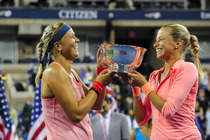 Lucie Hradecka and Andrea Hlavackova kiss the women's doubles championship trophy after their 6-7, 6-1, 6-4 victory against Ashleigh Barty and Casey Dellacqua on Day 13 of the 2013 US Open.