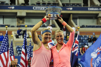 Lucie Hradecka and Andrea Hlavackova hoist the women's doubles championship trophy after their 6-7, 6-1, 6-4 victory against Ashleigh Barty and Casey Dellacqua on Day 13 of the 2013 US Open.