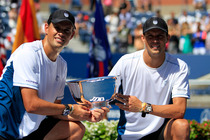 Bob and Mike Bryan hold up the trophy after winning the Men's Doubles Championship in Arthur Ashe Stadium.