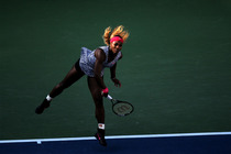 Defending champion Serena Williams serves to Caroline Wozniacki during the 2014 US Open Women's Championship match.