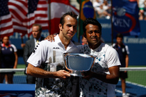 Leander Paes and Radek Stepanek pose with the trophy after their 6-1, 6-3 victory over Alexander Peya and Bruno Soares in the in the men's doubles final.