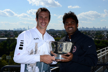 Leander Paes and Radek Stepanek pose with the trophy after winning the men's doubles championship at the 2013 US Open.