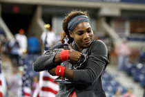 Women's singles champion and No. 1 seed Serena Williams holds the trophy after taking the 2013 US Open title over Victoria Azarenka, 7-5, 6-7, 6-1.