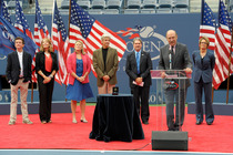 The family of Tony Trabert, as well as USTA President Dave Haggerty, International Tennis Hall of Famer Stan Smith and emcee Mary Carillo, celebrate Trabert's induction into the US Open Court of Champions.
