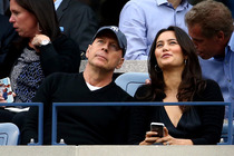 Actor Bruce Willis (L) and his wife, model and actress Emma Heming watch as Marin Cilic of Croatia plays against Kei Nishikori of Japan during the men's singles final of the 2014 US Open.