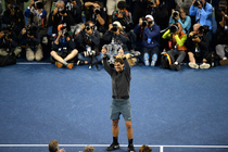 No. 2 seed Rafael Nadal wins the 2013 US Open over top seed Novak Djokovic 6-2, 3-6, 6-4, 6-1 and holds up the winner's trophy.