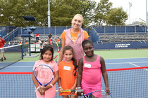 Elena Vesnina having fun with kids at the Returning the Love tennis clinic on Day 3 of qualifying.