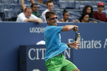Tommy Robredo whips a forehand during a practice session in Arthur Ashe Stadium.