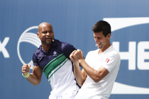 Shawn T gives Novak Djokovic a workout on Arthur Ashe Kids' Day.