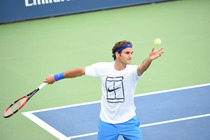 No. 2 seed Roger Federer practices his serve before the start of the US Open.