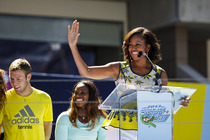 First Lady Michelle Obama greets the audience at the Arthur Ashe Kids' Day stadium Show during the US Open.