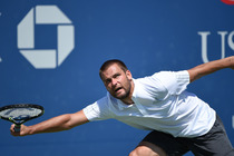 Mikhail Youzhny stretches to return a shot in the first round of the US Open.